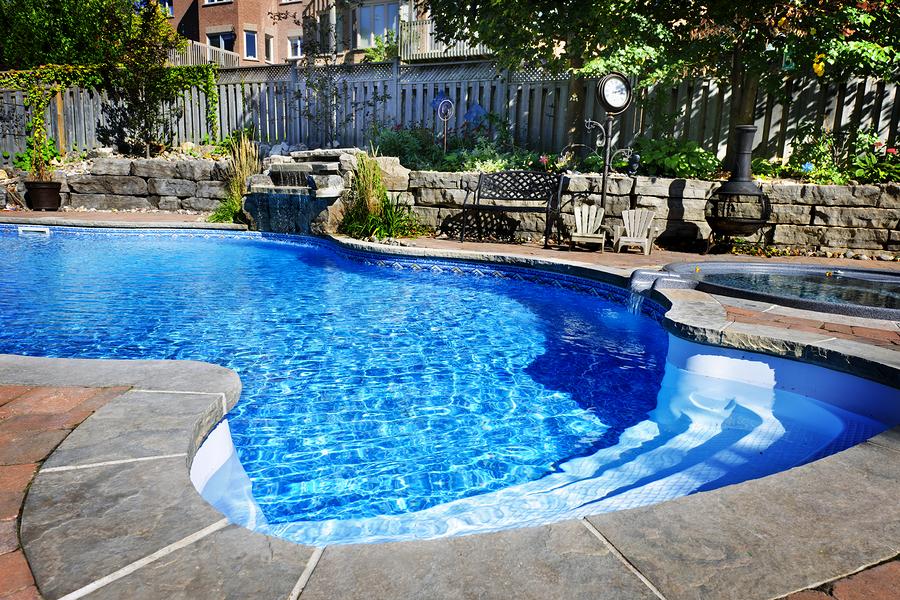 bigstock-Swimming-Pool-With-Waterfall-31343315